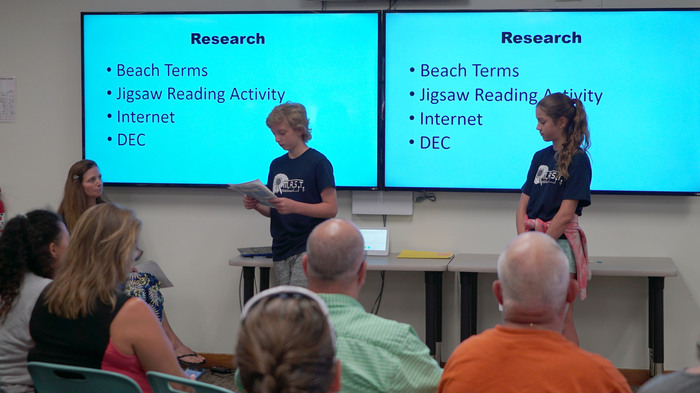 students give presentations on their research