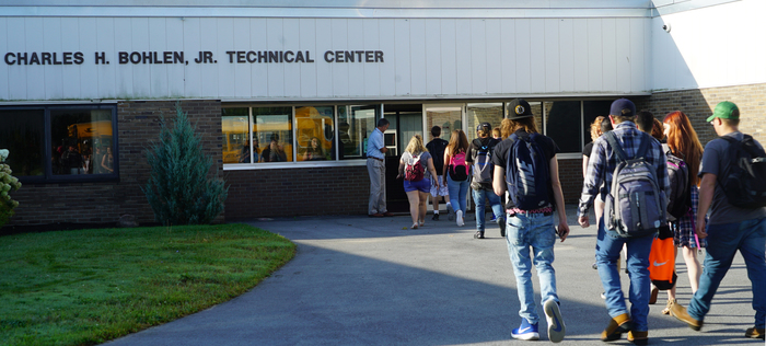 Students entering the tech center building
