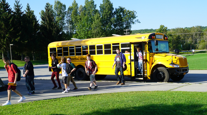 students getting off a school bus