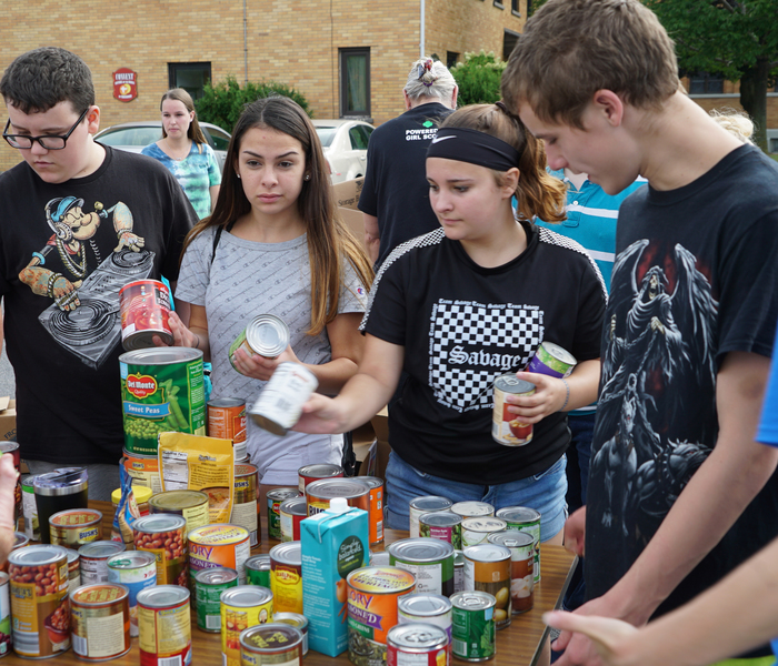 students sort through donated food items