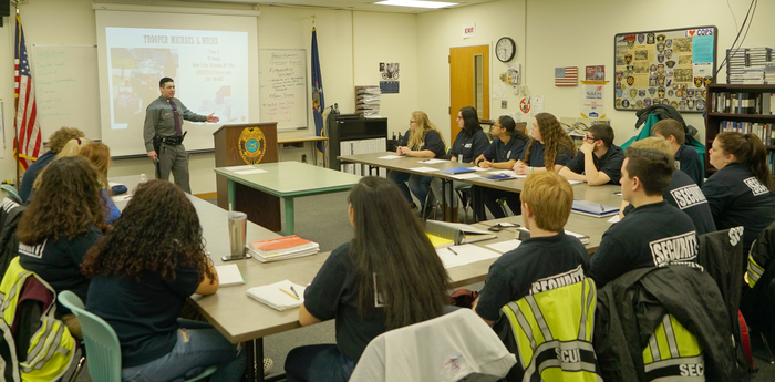 state trooper speaks to students in classrookm