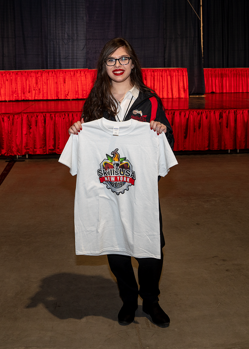 Brooke holding the tshirt with her design