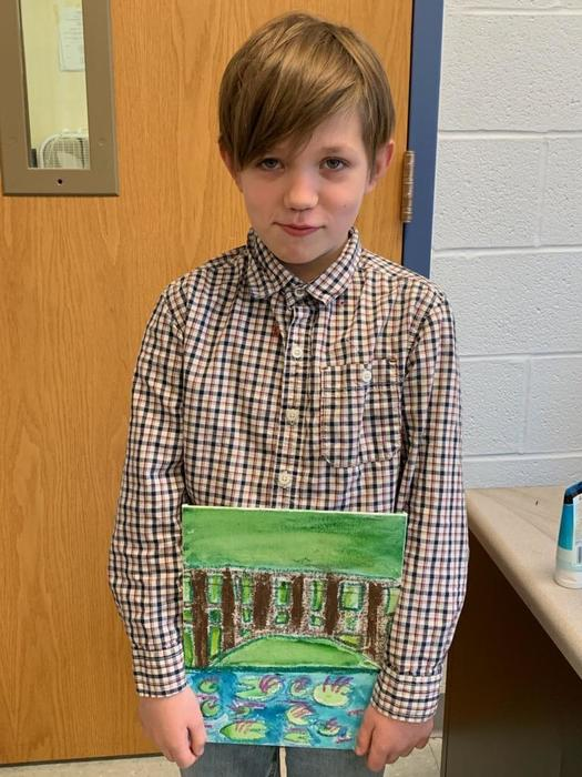 Jayden with his painting
