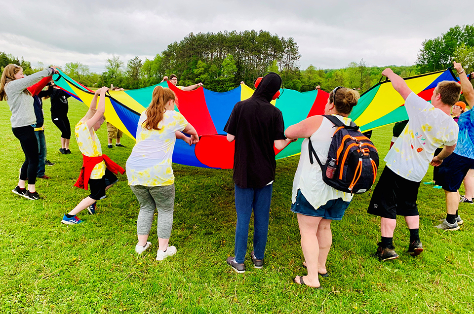 students playing with parachute
