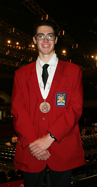 Andrew Kirkwood posing with medal