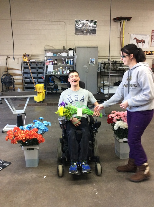 Ryan receiving flowers from fellow student Abigail Haigh
