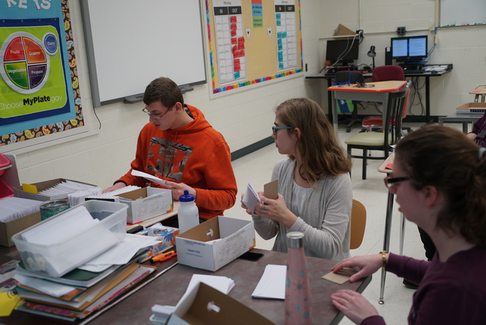 students prepare mailings