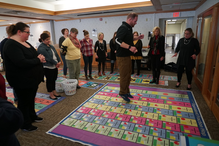 participant jumps on fraction mat