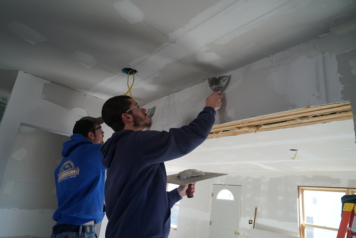 students installing drywall