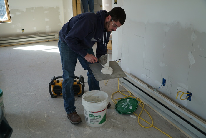 student preparing drywall