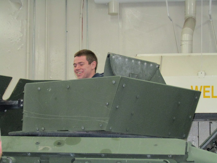 student looks out humvee
