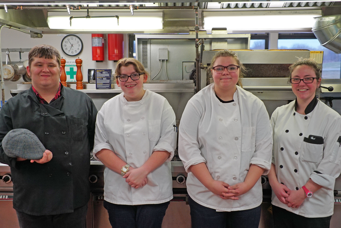 The Culinary Arts students who made the food posing for a picture