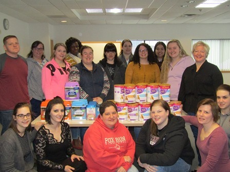 Adult Practical Nursing students with their donated baby formula