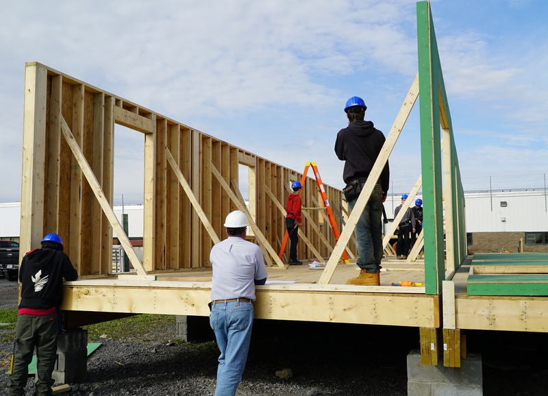 Students work on building duplex