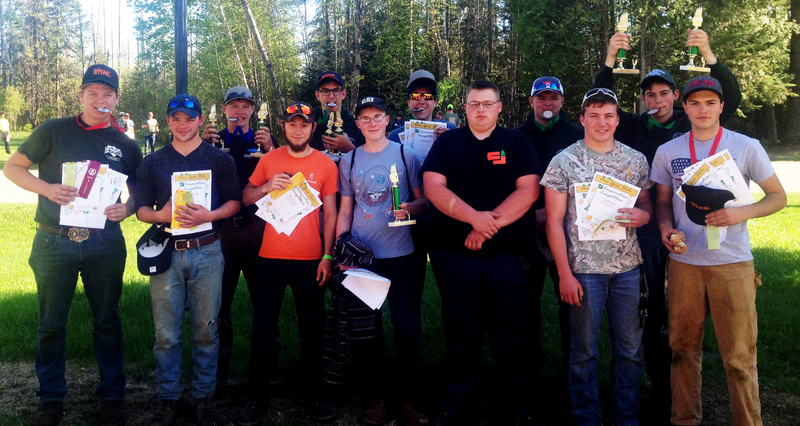 Forestry students pose with medals, trophies and certificates