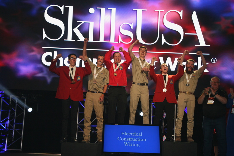 Andrew and other medal winners on stage