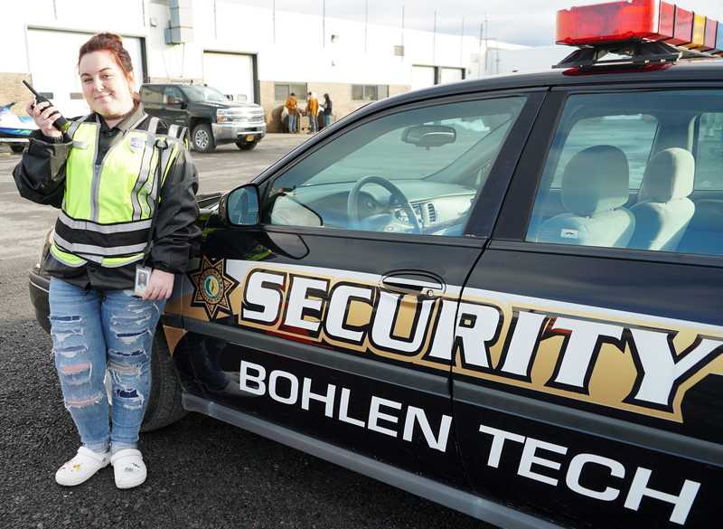 Hayley in front of BTC patrol car